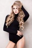 Young sexy blonde girl posing in studio. Stock Photos