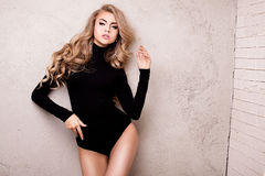 Young sexy blonde girl posing in studio. Royalty Free Stock Photography