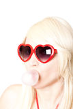 Young sexy blonde in heart-shaped glasses Royalty Free Stock Image