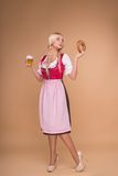 Young sexy blonde wearing dirndl Stock Photography