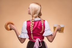 Young sexy blonde wearing dirndl Royalty Free Stock Images