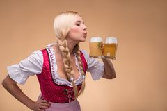 Young sexy blonde wearing dirndl Stock Image