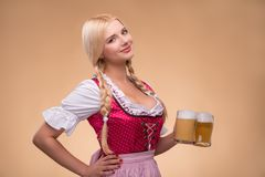 Young sexy blonde wearing dirndl Stock Photos