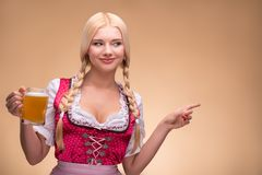 Young sexy blonde wearing dirndl Stock Images