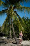 Young blonde woman in beach dress near sea. Girl at the beach stock images