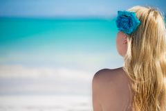 Young blonde woman in bikini near sea. Girl at the beach royalty free stock photos