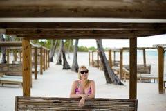 Young blonde woman in bikini near sea. Girl at the beach stock photos