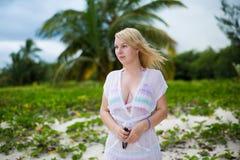 Young blonde woman in bikini near sea. Girl at the beach stock photo