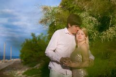 Young blonde woman and man at romantic date at vacation. Young blonde women and men at romantic date at vacation royalty free stock photo