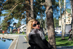 Young sexy blonde woman in a park. Young sexy attractive woman with long blonde hair in a park Stock Photo
