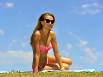 Young blonde woman in pink bikini having sunbath in summer royalty free stock photo