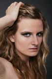 Young blonde woman portrait on gray isolated Royalty Free Stock Photography