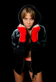 Young sexy boxing girl with wrapped hands and wrists in hoodie jumper ready for fight. Young sexy angry and dangerous looking boxing girl with wrapped hands and Royalty Free Stock Image