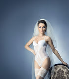 Young sexy bride in erotic lingerie over blue Stock Photo