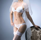 Young sexy bride in erotic lingerie over blue Royalty Free Stock Photo