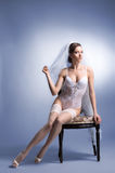Young sexy bride posing in erotic lingerie Stock Photo