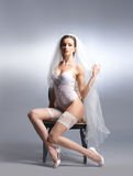 A young and sexy bride in white lingerie Royalty Free Stock Photography