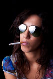 Young, sexy brunette with cigarette and sunglasses Stock Photo