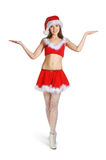 A young and sexy brunette girl in a Santa costume Stock Image