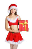 A young and sexy brunette girl in a Santa costume Stock Photos