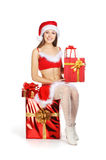 A young and sexy brunette girl in a Santa costume Royalty Free Stock Image