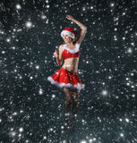 A young and sexy brunette girl in a Santa costume Royalty Free Stock Photography