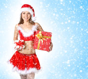 A young and sexy brunette girl in a Santa costume Stock Photo