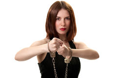 Young sexy brunette in handcuffs Royalty Free Stock Images