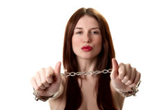 Young brunette in handcuffs Royalty Free Stock Photography