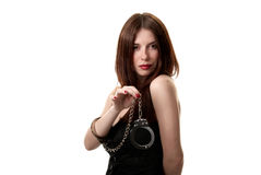 Young sexy brunette in handcuffs Stock Photography