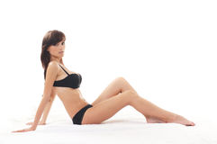 A young and sexy brunette laying in black lingerie Royalty Free Stock Photo