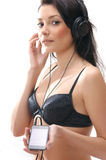 A young and sexy brunette listening to the music Royalty Free Stock Photos