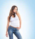 A young and sexy brunette posing in stylish jeans Royalty Free Stock Photo