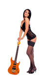 A young and sexy brunette rockstar Royalty Free Stock Images