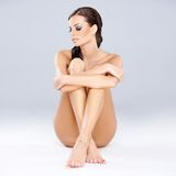 Young sexy brunette sitting while  Stock Image