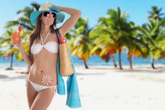 Young sexy brunette in white swimsuit Royalty Free Stock Photo