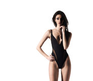 A young and sexy brunette woman in a black swimsuit Royalty Free Stock Photo