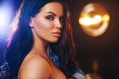 Young woman portrait. Young sexy brunette woman portrait with warm and cold lights Royalty Free Stock Images
