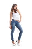 A young and sexy brunette woman in stylish jeans Stock Images