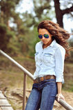 Young sexy brunette woman in sunglasses Royalty Free Stock Image