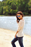Young sexy brunette woman in sunglasses Royalty Free Stock Images