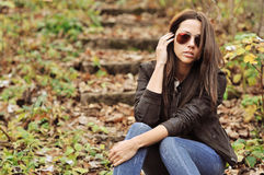 Young sexy brunette woman in sunglasses Royalty Free Stock Photography