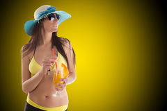 Young sexy brunette in yellow swimsuit Royalty Free Stock Photo