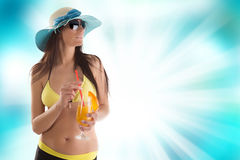 Young sexy brunette in yellow swimsuit Royalty Free Stock Image