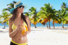 Young sexy brunette in yellow swimsuit Royalty Free Stock Photography