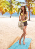 Young sexy brunette in yellow swimsuit Stock Photography