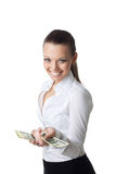 Young sexy business woman offer dollars Royalty Free Stock Photos