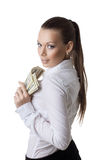 Young business woman take a bundle of dollars Royalty Free Stock Photography