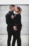 Young sexy couple in black clothes hugging on street Royalty Free Stock Images