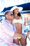 Young and sexy couple drinking shampagne on a boat Stock Image